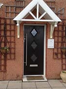 black composite door with contemporary hardware