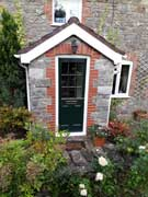 green cottage style composite door