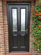 black composite door with a black frame