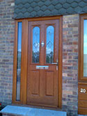 composite door with a fully glazed side panel in oak