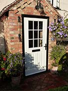 white cottage style composite front door
