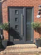 composite front door and side panel in grey